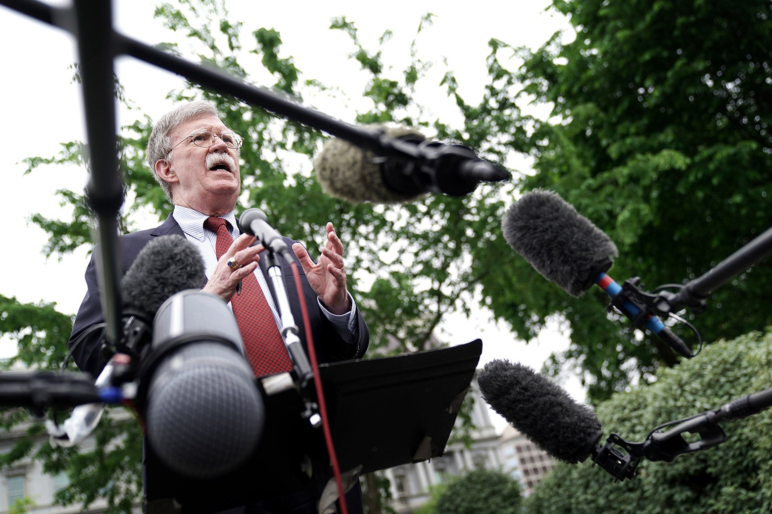 National security adviser John Bolton talks to reporters outside the West Wing on May 1 in Washington.