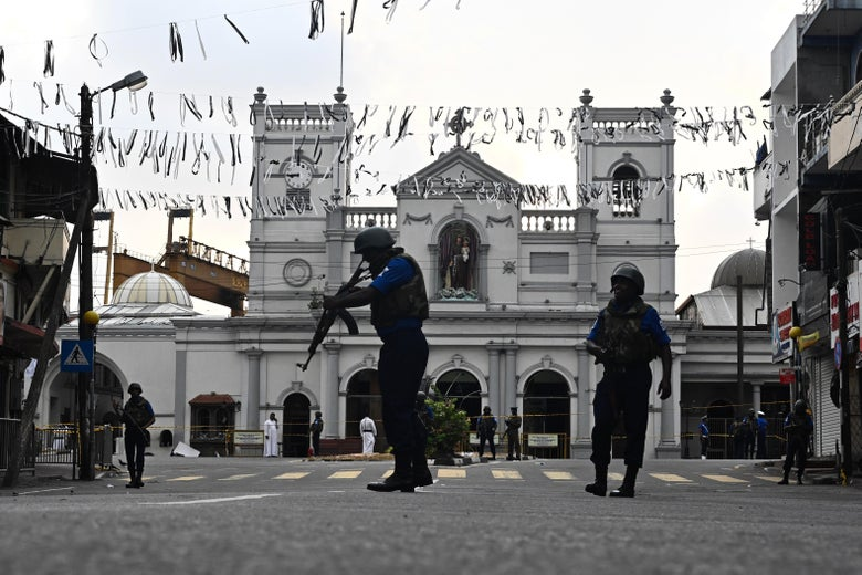 Security personnel stand guard in front of St. Anthony's Shrine in Colombo.
