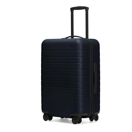 A dark-blue rolling suitcase.