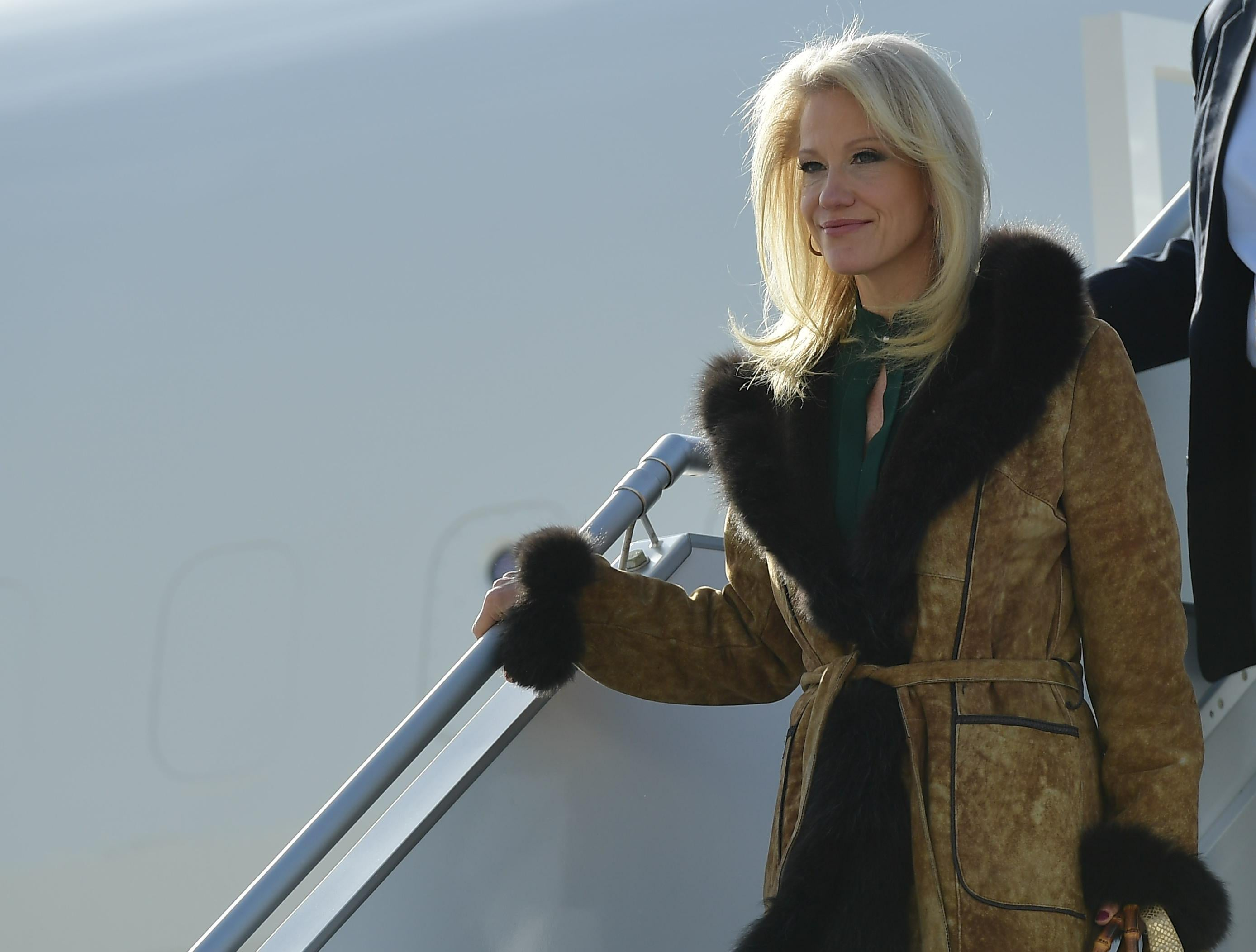 White House counselor Kellyanne Conway steps off Air Force One.