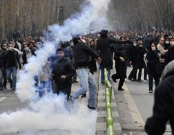 Iranian protestors dispersed with tear gas. Click image to expand.
