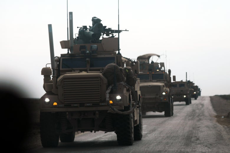 U.S.-backed coalition military vehicles during an operation to expel ISIS from the eastern Syrian province of Deir Ezzor on Feb. 21, 2019.