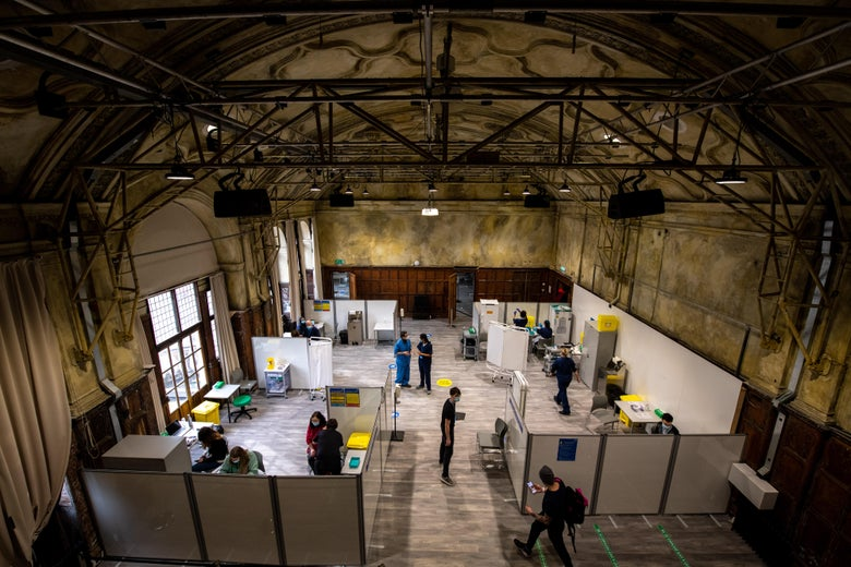An aerial view of a warehouse-like vaccine center.