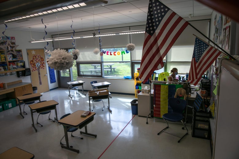 U.S. flags wave over a classroom with empty desks.