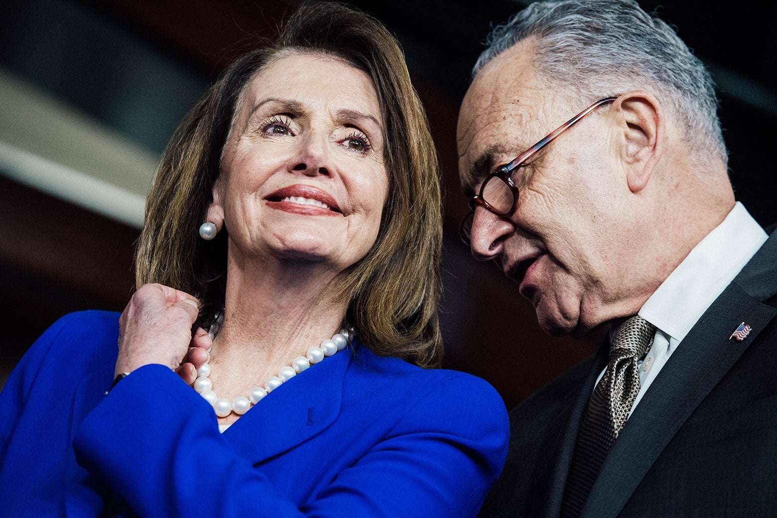 Nancy Pelosi and Chuck Schumer confer.