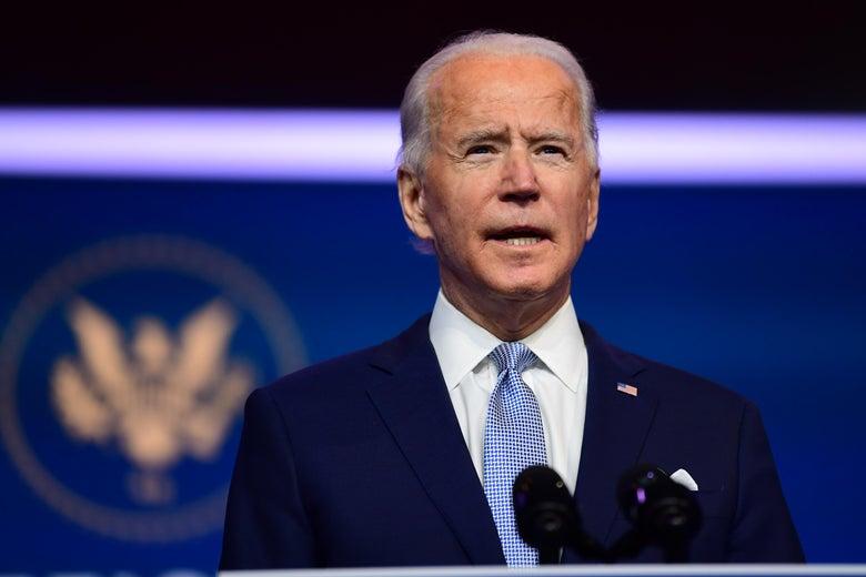 Biden speaks at a podium onstage