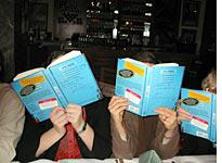 Some total strangers reading my book in a restaurant