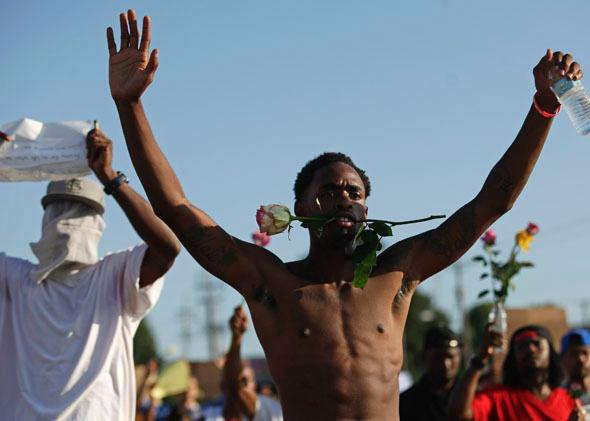 Demonstrators protest against the fatal shooting of Michael Brown in Ferguson, Missouri, Aug. 19, 2014.