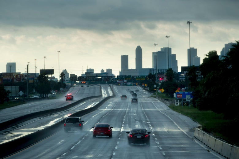 Cars are seen driving on a highway.