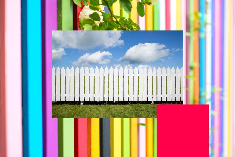 Rainbow picket fence surrounding a white picket fence.