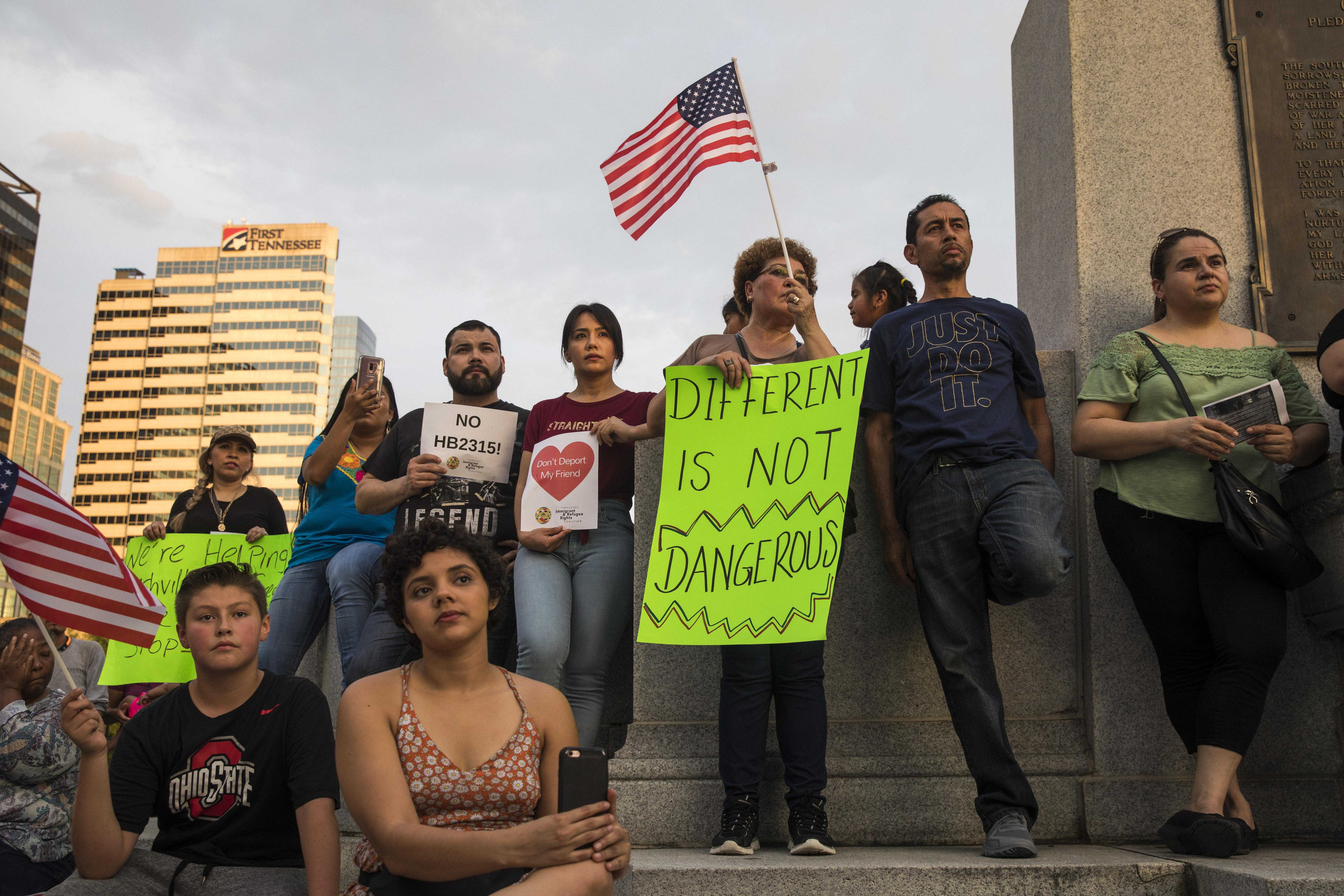 Activists rally and hold signs outside the Tennessee State Capitol