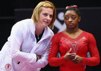 Simone Biles talks with her coach Aimee Boorman during warm ups before the Sr. Women's 2016 Secret U.S. Classic at the XL Center on June 4, 2016 in Hartford, Connecticut.
