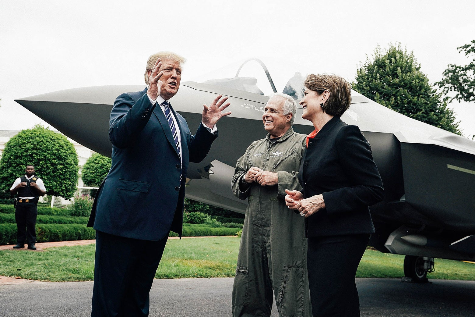 U.S. President Donald Trump talks to Lockheed chief test pilot Alan Norman and CEO Martin Marillyn Hewson in front of an F-35 fighter jet during the 2018 Made in America Product Showcase on July 23.