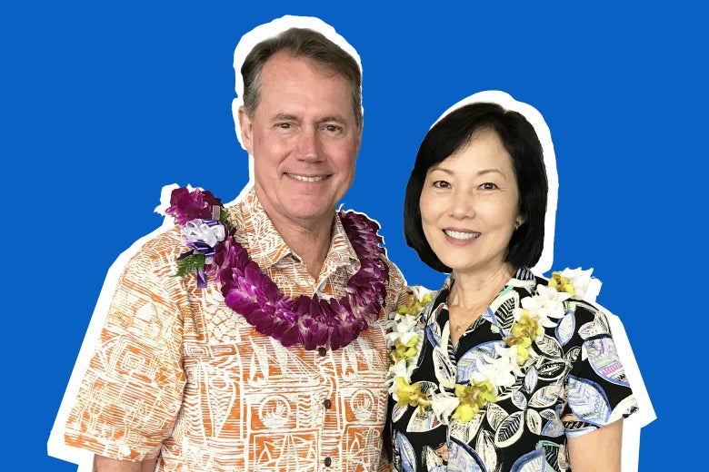 Ed Case and his wife, both wearing Hawaiian shirts and leis.