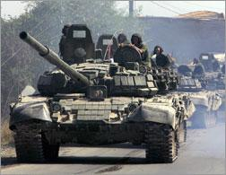 Russian tanks roll on a street in Tskhinvali. Click image to expand.
