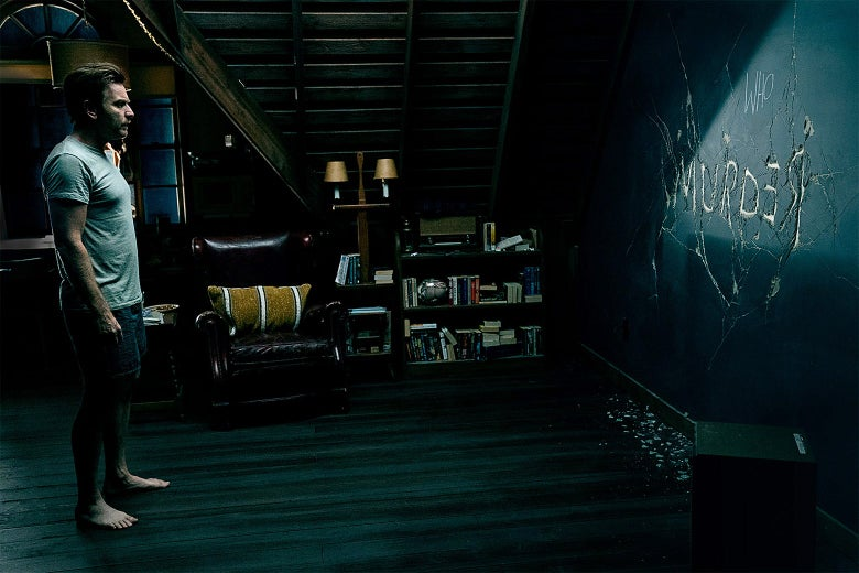 In a still from Doctor Sleep, McGregor stands in a creepy room and stares at a wall that has the word MURDER carved into it.