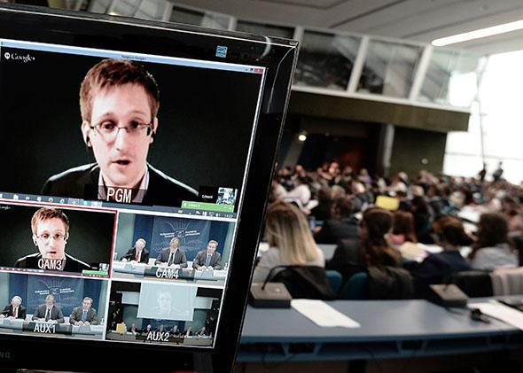 American National Security Agency (NSA) whistleblower Edward Snowden speaks to European officials via video-conference during a parliamentary hearing on mass surveillance at the European Council.