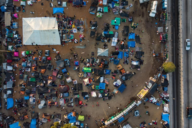 Aerial view showing the temporary shelter for the Central American migrants who want to reach the United States in hope of a better life, in Tijuana, Baja California State, Mexico, near the U.S.-Mexico border fence on November 24, 2018.