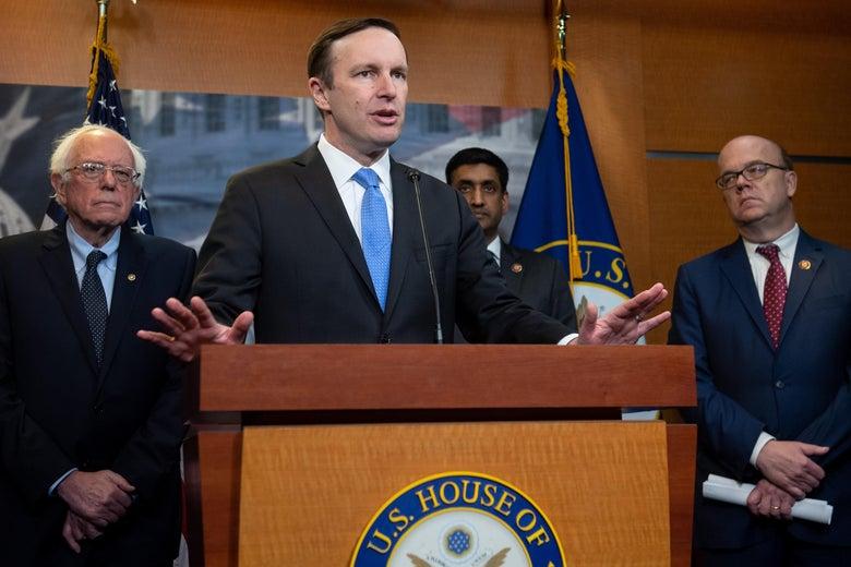 Sen. Chris Murphy speaks alongside Sen. Bernie Sanders, Rep. Ro Khanna, and Rep. Jim McGovern.