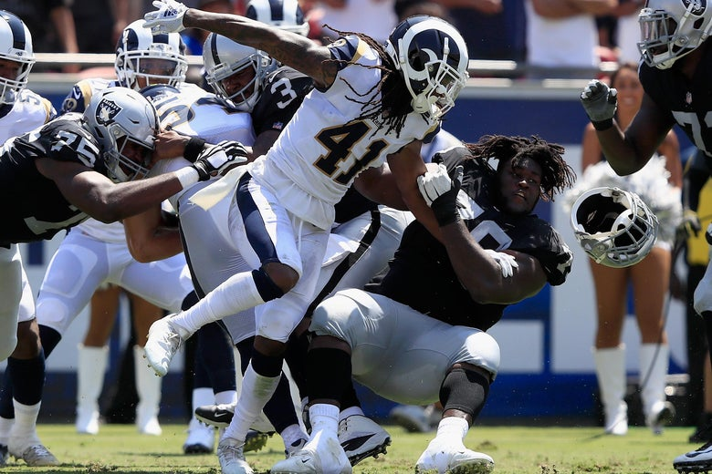 LOS ANGELES, CA - AUGUST 18:  Denver Kirkland #79 of the Oakland Raiders has his helmet knocked offsides by Marqui Christian #41 of the Los Angeles Rams during the first half of a preseason game at Los Angeles Memorial Coliseum on August 18, 2018 in Los Angeles, California.  (Photo by Sean M. Haffey/Getty Images)