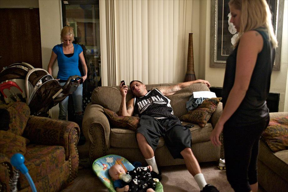 Paul lounges in his home with his girlfriend and his son after a day of shooting in Los Angeles, Aug. 12, 2009.