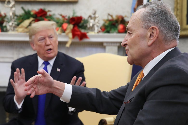 President Donald Trump argues about border security with Senate Minority Leader Chuck Schumer (D-NY) in the Oval Office on December 11, 2018 in Washington, D.C.