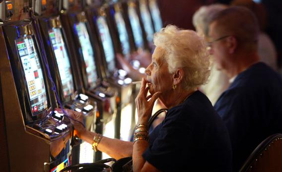 Joan Ouellette plays a slot machine in 2004 during the grand opening for the Seminole Hard Rock Hotel and Casino.