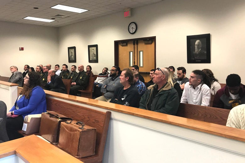 Customs and Border Protection Officer Mark Qualter testifies in Plymouth District Court as Judge Thomas Rappa looks on.