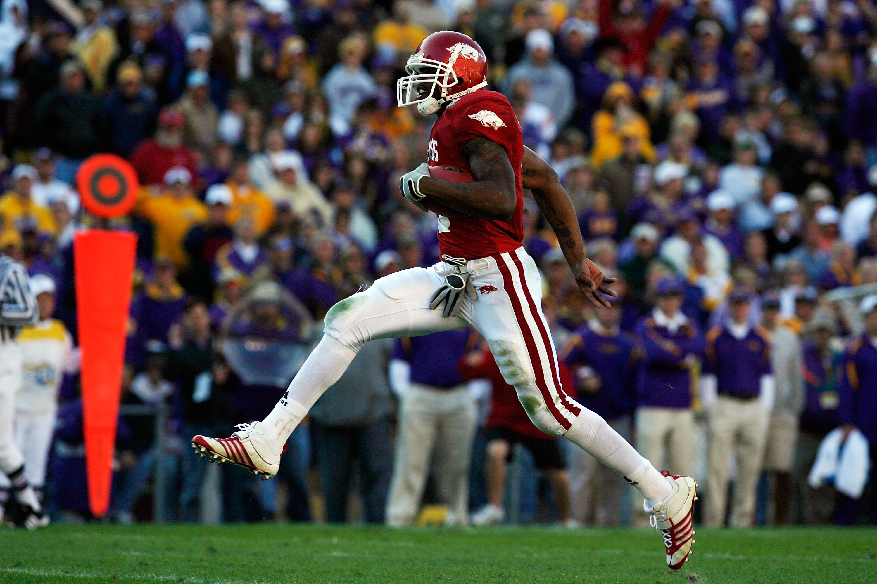 Darren McFadden, then of the Arkansas Razorbacks, runs for a touchdown against the Louisiana State University Tigers to score a touchdown at Tiger Stadium Nov. 23, 2007, in Baton Rouge, Louisiana.
