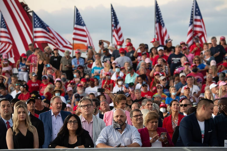 Supporters of President Donald Trump attend a Make America Great Again rally as he campaigns at Orlando Sanford International Airport in Sanford, Florida, October 12, 2020.