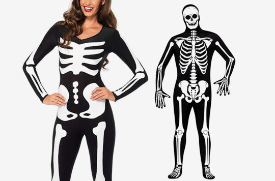 Couple dressed as skeletons.