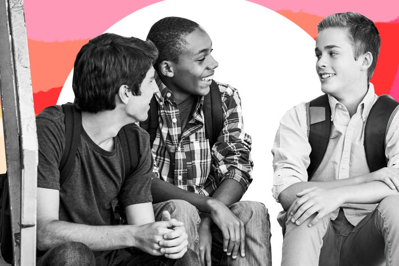 Teen boys of different races seated and talking.