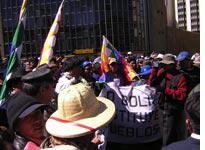 Evo Morales (in the center in a white shirt wearing a garland), marching. Click on image to enlarge.