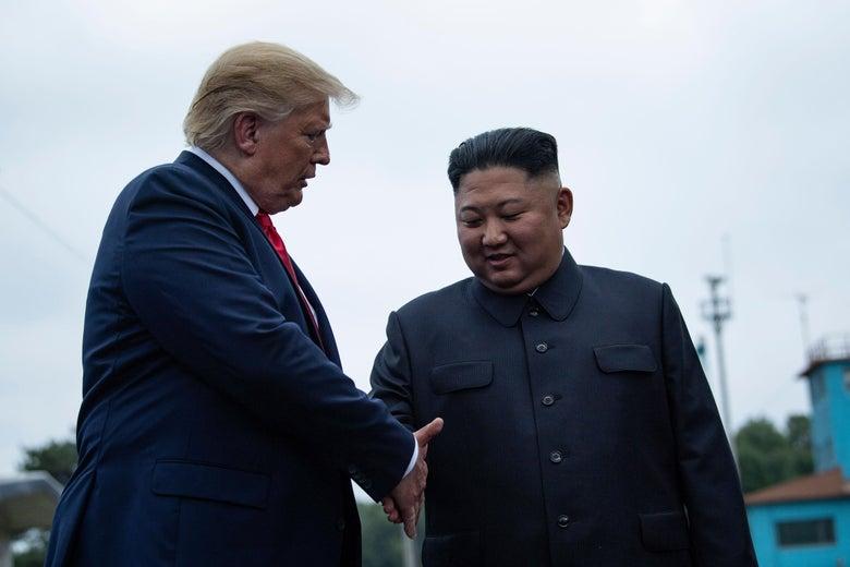 Trump and Kim shake hands.
