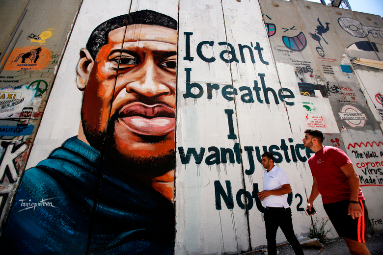 """A mural of George Floyd's face with the words, """"I can't breathe. I want justice."""""""