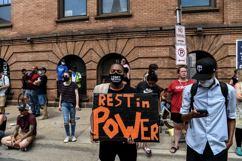 People gather outside of the memorial service in honor of George Floyd on June 4, 2020, in Minneapolis, Minnesota. - On May 25, 2020, Floyd, a 46-year-old black man suspected of passing a counterfeit $20 bill, died in Minneapolis after Derek Chauvin, a white police officer, pressed his knee to Floyd's neck for almost nine minutes. (Photo by CHANDAN KHANNA / AFP) (Photo by CHANDAN KHANNA/AFP via Getty Images)
