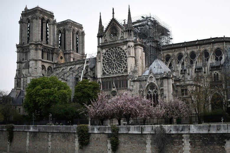 Exterior of Notre Dame Cathedral after the fire. Scaffolding can be seen, and the spire is gone.