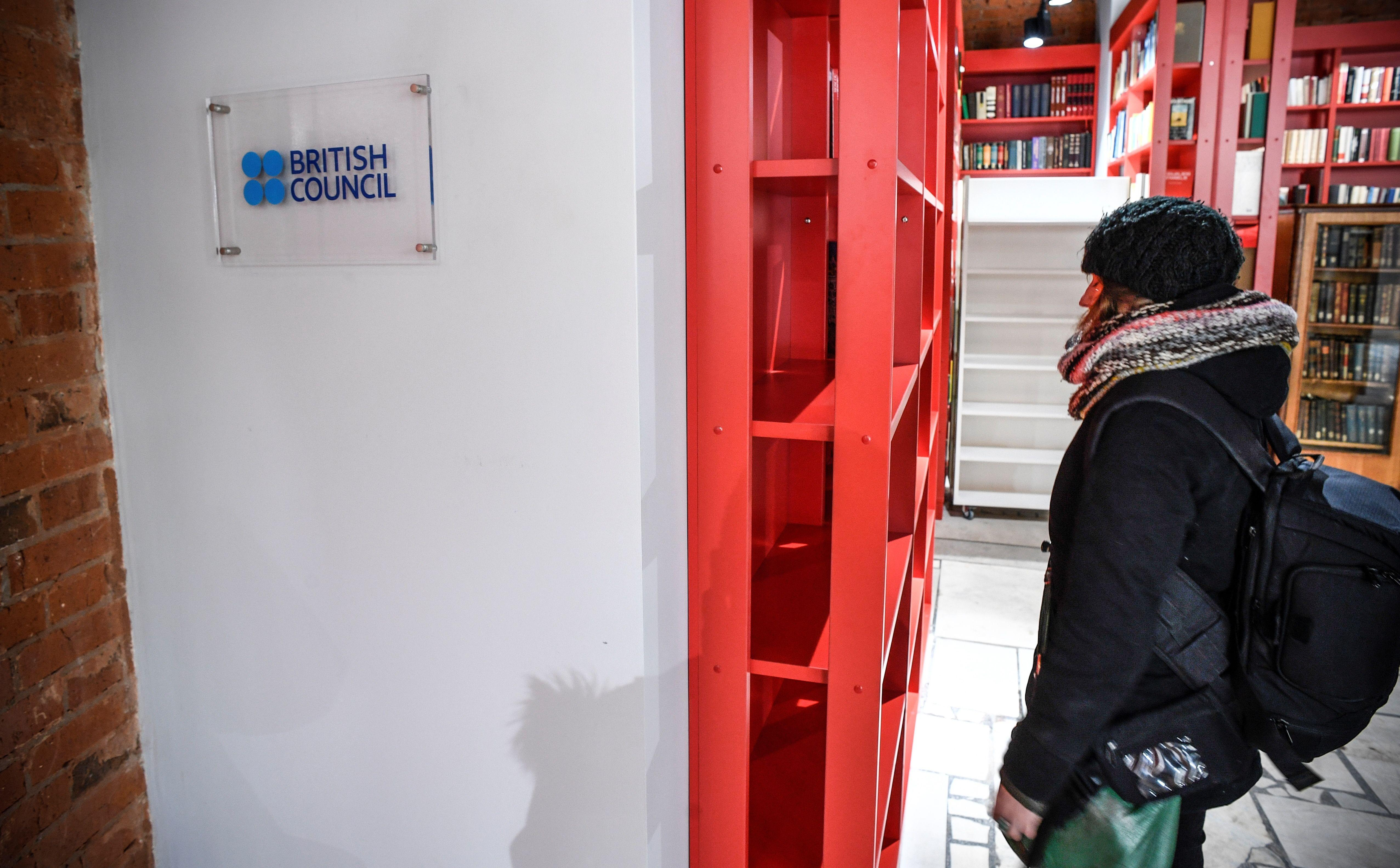 A woman stands next to the entrance of the British Council office in Moscow on March 2018.