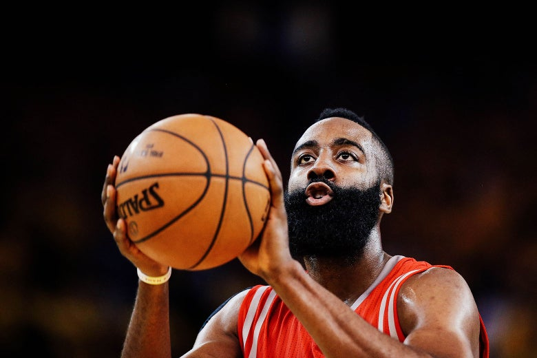 James Harden of the Houston Rockets shoots a free throw against the Golden State Warriors during Game 1 of the Western Conference Finals of the 2015 NBA Playoffs at Oracle Arena on May 19, 2015, in Oakland, California.