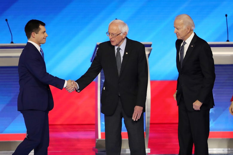 Democratic presidential candidates former South Bend, Indiana Mayor Pete Buttigieg, Sen. Bernie Sanders, and former Vice President Joe Biden greet each other prior to the start of the Democratic presidential primary debate in the Sullivan Arena at St. Anselm College on February 7, 2020 in Manchester, New Hampshire.