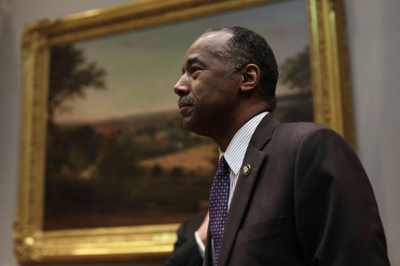 Ben Carson standing by a painting in the White House.