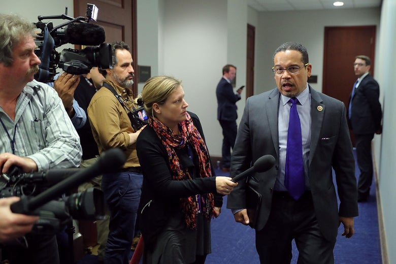 Rep. Keith Ellison talks to reporters as he leaves a House Democratic caucus meeting.