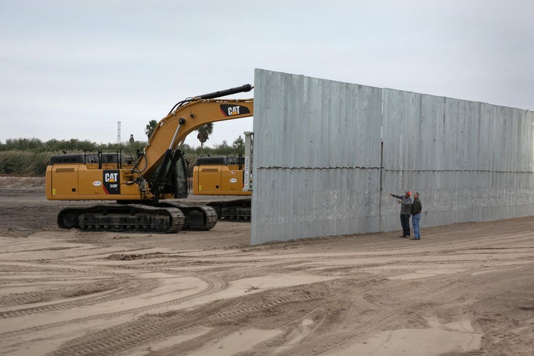 A construction crew works on a section of privately built border wall on December 11, 2019 near Mission, Texas.