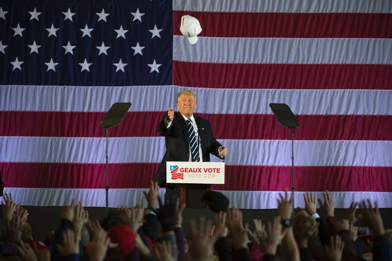Donald Trump tosses a campaign hat to supporters at a rally on December 9, 2016, in Baton Rouge, Louisiana.