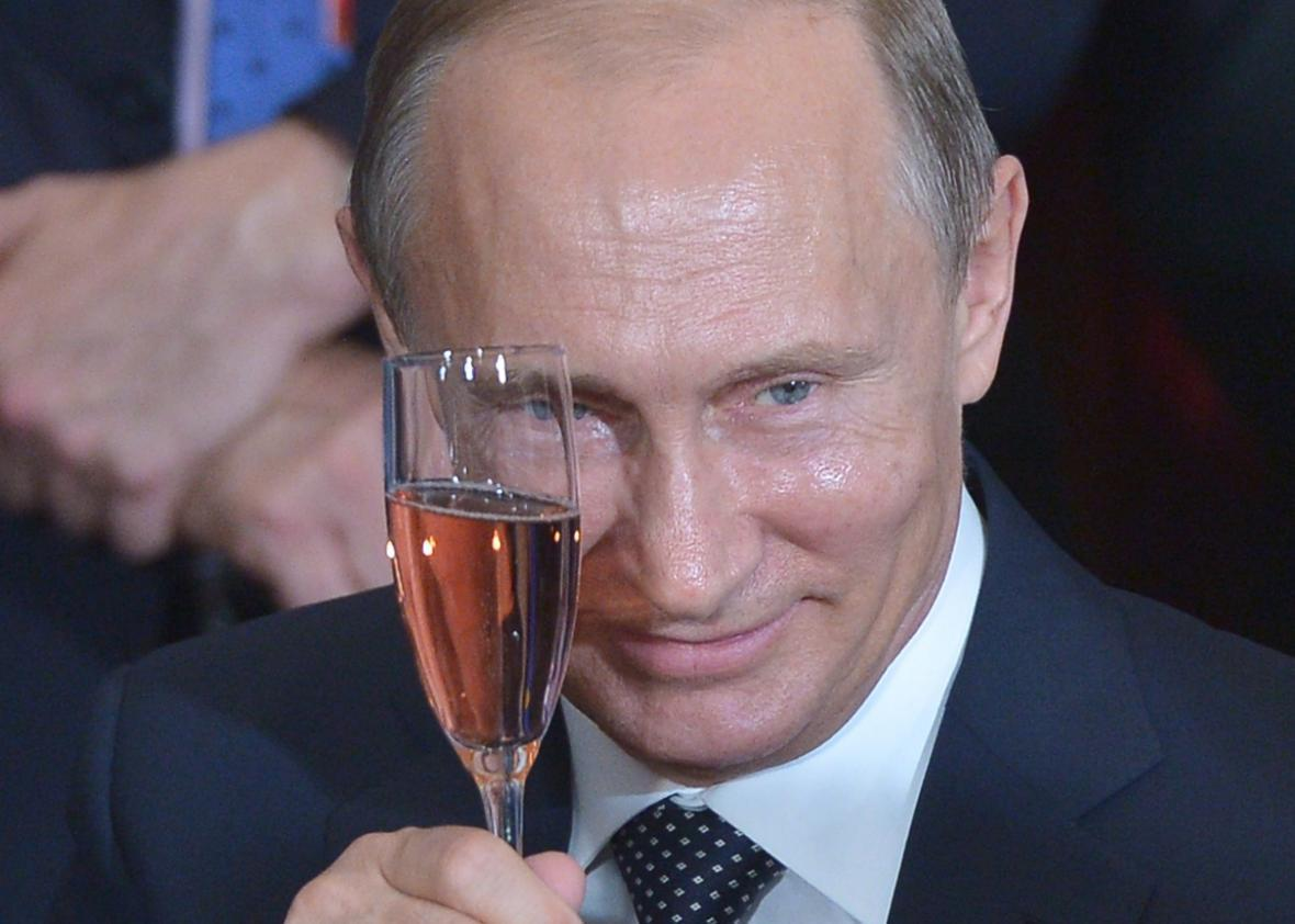 Vladimir Putin toasts during a luncheon hosted by U.N. Secretary-General Ban Ki-moon at the United Nations headquarters on Sept. 28, 2015, in New York.