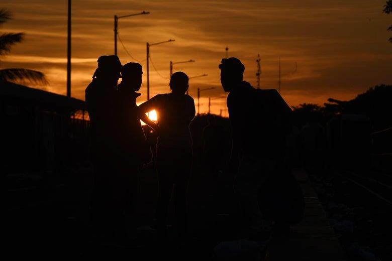 Honduran migrants in the caravan crossing from Guatemala into Mexico.