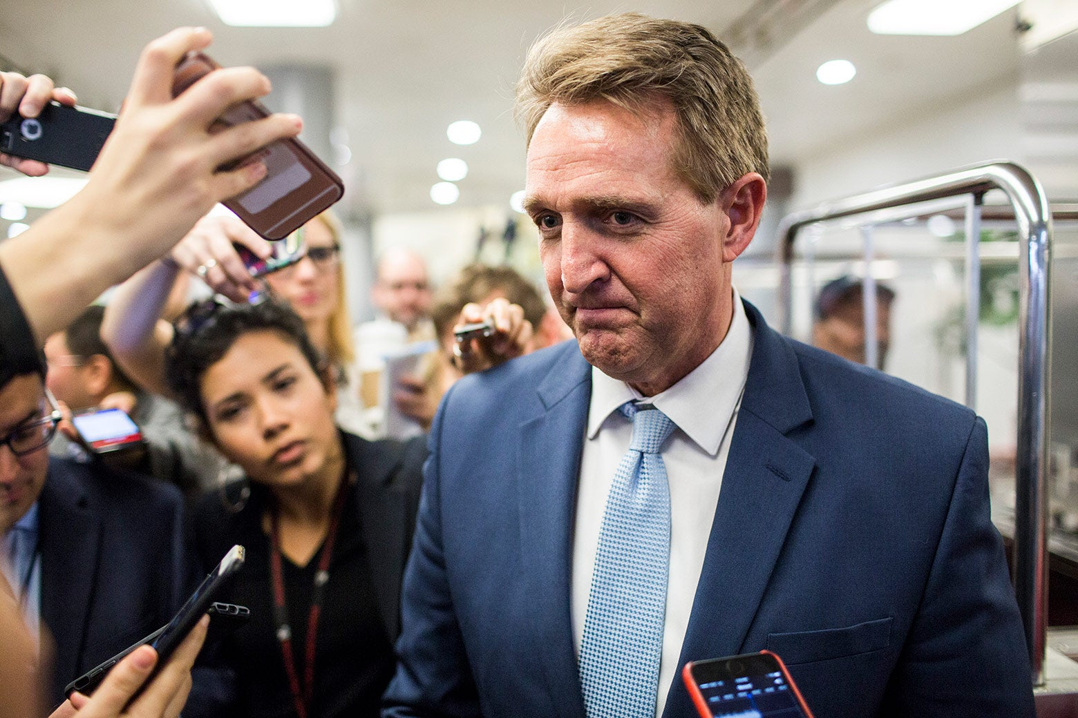 Arizona Sen. Jeff Flake speaks to reporters following a vote on Capitol Hill on Thursday in Washington.