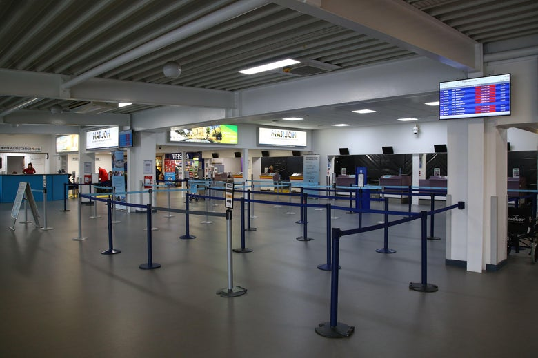 Empty check-in desks are pictured inside Exeter Airport.