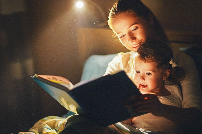 Mother reading to her young child.