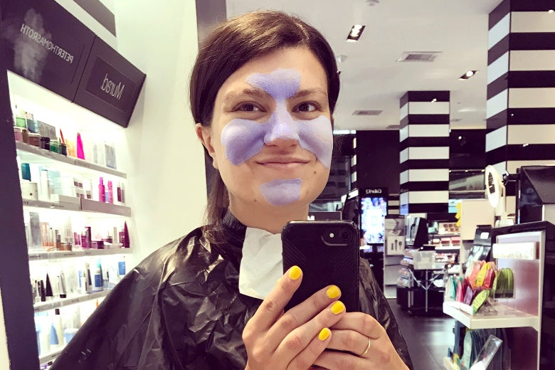 The author in a facial mask at Sephora.